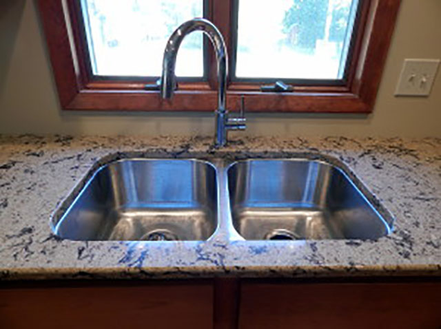 Detail view of countertop at sink.