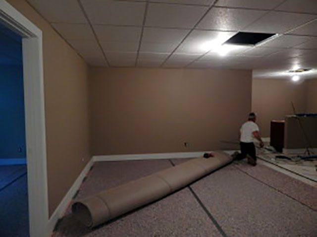 Carpet installation in the Lower Level.