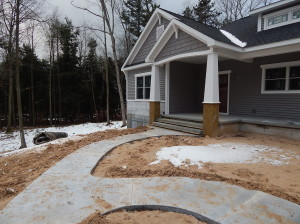 Main entry sidewalk poured.