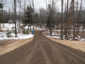 Driveway graded and lined with gravel.