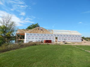 Trusses are set and house is wrapped.