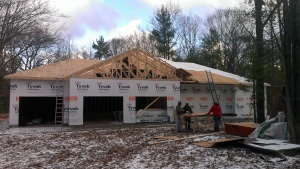Working on sub-fascia and roof sheeting.