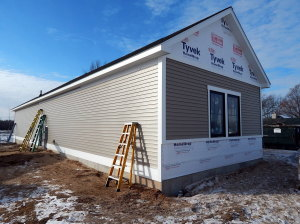 Beginning to install the siding.