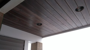 Tongue and groove ceiling on the Main Level Deck, stained to match the decking.
