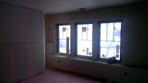 A Lower Level Bedroom with window seat built in at left.