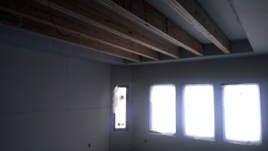 Master Bedroom has a tray ceiling with decorative beam detail.