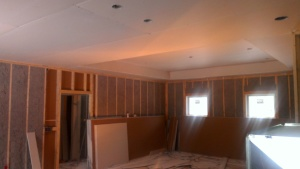 House is insulated and drywall has started. This is standing int he Kitchen look over the Living area.