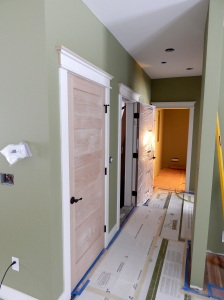 Looking down the hallway toward the Laundry Room and Master Bedroom.