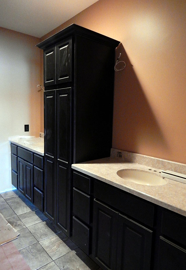 master bath cabinets and tops installed mirrors and light fixtures to