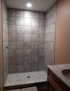 Shower tile complete in a Guest Bathroom.