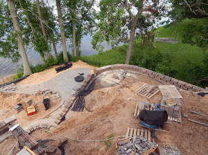 Landscape work continues on the Lake side of the house. Finishing up the retaining wall and starting the pavers steps to the water and fire pit.