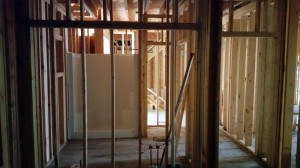 Inside progress has included mechanical rough-in. This photo shows the Main Level guest bathroom.