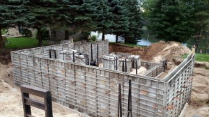 Footings poured and foundation forms going up.