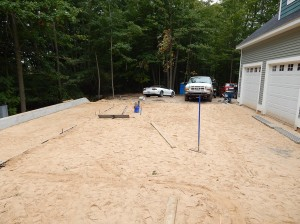 Preparing to pour the driveway pad.