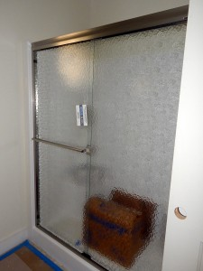 Shower doors have also been installed.