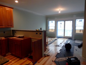 Working on Dining Room wood flooring.