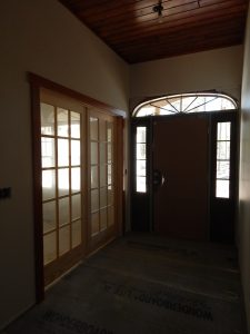 Foyer with French doors to Sewing Room.