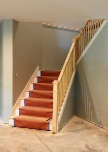 Stair rail, risers, and treads installed.