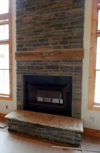Granite was installed recently, fireplace just needs a hearth now.